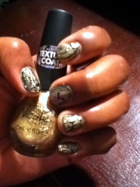 My nails are decked out in Nicole by O-P-I Gold Shatter polish over a black base coat. This photo does not do them justice bcause they appear much cooler. I do have one quarrel, the price is too damn high. This bottle of polish cost $7.00!