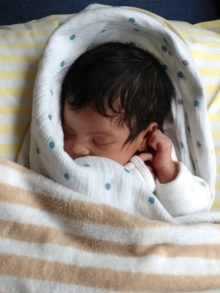 She is beautiful and has a head full of hair! Click image for more pictures of Blue with Mommy and Daddy!