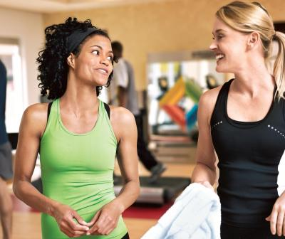 Women-Exercise-Together-at-Gym