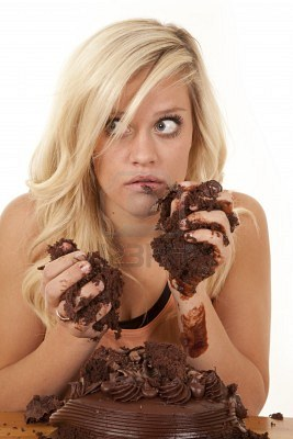 12104638-a-woman-chocolate-cake-all-over-her-face-and-hands-with-a-shocked-expression-on-her-face
