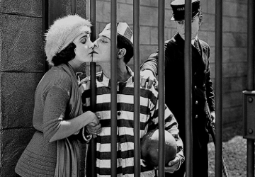 Woman Kissing Prisoner