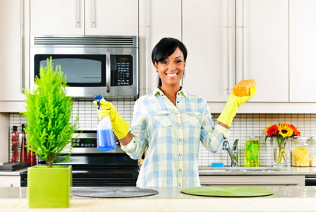 happy-woman-cleaning-kitchen