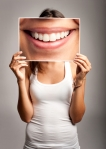 woman-holding-smile-photo-in-front-of-face_3