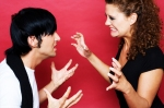 young-couple-fighting-against-red-background