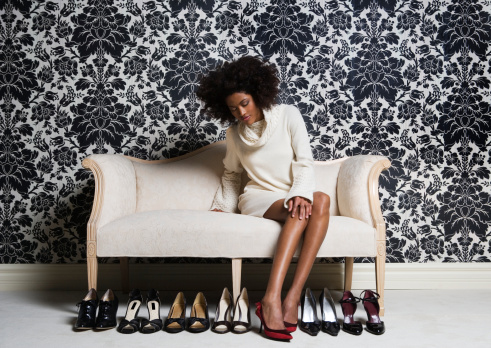 woman-on-sofa-with-shoes