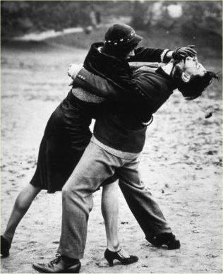 woman beats man