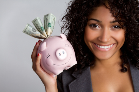 pretty-black-woman-holding-piggy-bank